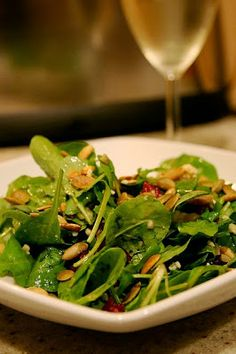 12 Healthy Spinach Salads ~ Baby spinach topped with dried cranberries, Stilton cheese and toasted sunflower seeds.