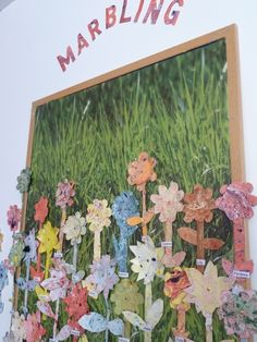 Spring Display: Using marbling inks, the children created their own patterned marbled paper and then cut out a flower.