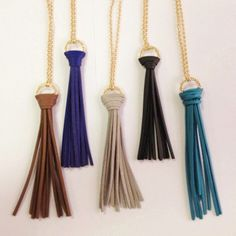 """Leather tassel necklaces Long leather tassel necklaces. Available in brown, blue, gray, black, and teal. 21"""" with closed clasp. Tassel is 4"""" long. PLEASE REQUEST A SEPARATE LISTING STATING WHICH COLOR. Jewelry Necklaces"""