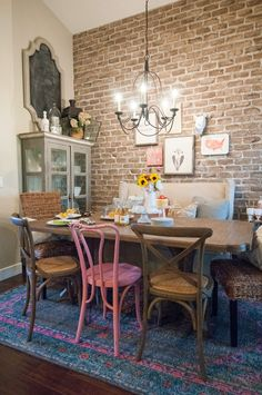 The Black Goose Design blog- Eclectic dining room with exposed brick wall, mismatched chairs, and a Surya Zahra rug. (ZHA-4006)