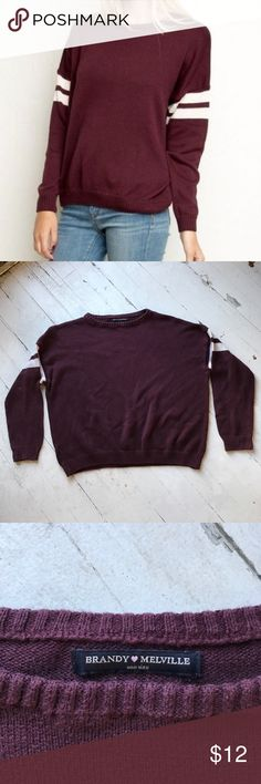 brandy melville maroon varsity sweater burgundy/maroon knit sweater with white varsity rings on arms, there was a hole in the arm but it got stitched so there's just a small fold or seam but not noticeable at all, otherwise no other flaws. Brandy Melville Sweaters