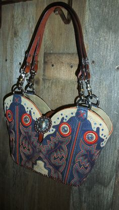 #672-12 Blue leather cowboy boot purse with orange stitching and blue crystals
