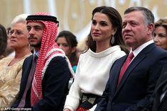 King Abdullah II (R) and Queen Rania (C) of Jordan sit near Crown Prince Hussein (2nd L) a...
