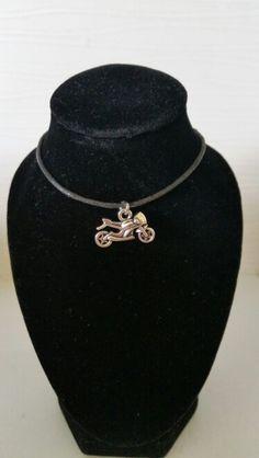 Motorbike pendant on cord. AUS $ 5.00