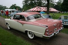 1955 Dodge. My two-door hardtop '55 was just like this except the colors were green and white. I had spinner hubcaps too!