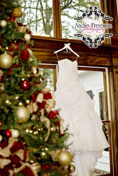Gown with sweetheart neckline hanging beside christmas tree christmas