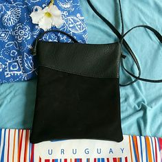 Imported Uruguyan leather black crossbody bag This one has a mixed of distress and regular leather pattern on the front, the back is like 75% suede, top is leather, top zipper gives acces to the full bag. the other  2 zippers are pockets and you can carry in there make up os cash or credit cards,  Please no lowballers  or trades. Bags Crossbody Bags