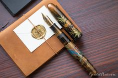 This fountain pen is full of power and beauty! The Namiki Maki-e Kylin fountain pen depicts a mythical creature. The Kylin is thought to have a compound appearance with a dragon's head, antlers, horse hoofs, an oxtail, wolf's forehead and a colorful chest. It is lively, intelligent and most of all gentle but valorous to ward off devils. Pin for later.
