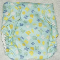 Flannel covered waterproof polyurethane.  Three snap sides with additional snap for the included soaker pad.  Use as a diaper or use as a diaper cover.  Additional soakers may also be purchased.