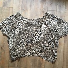 Leopard Print Top Slightly sheer leopard print top with cute open back detail. Size M but fits like a S/M. In perfect condition. PacSun Tops Blouses