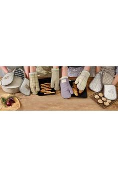 Get set for all your Christmas cooking with a set of 2 Wild Meadow Oven Mitts from Next.