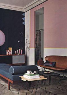Soft pink walls, blue/grey divan, herringbone floors. Dusky colours