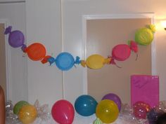 candy garland: tissue paper, paper plates, & ribbon