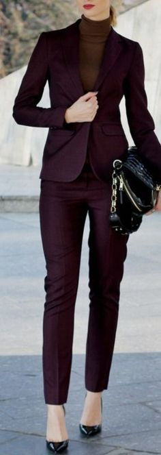 Office look. Brown turtle neck sweater and deep plum suit.