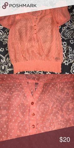 The Limited Top Coral orange color with white dots. Ruffle spandex bottom. Looks great with a white tank underneath. Sleeves are elbow - wrist length. 100% polyester. Great condition. Make an offer! The Limited Tops Blouses