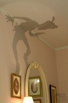 Cut-outs placed over top of a lamp create interesting shadows. I would even do this in my room!