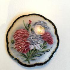 Gustav Gaudernack workshop. Brooch with hand painted chrysanthemum (?) motif on enameled guilloché gilt silver.