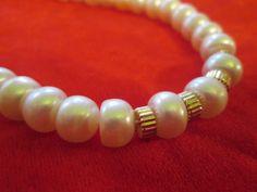 Collar de Perlas Cultivadas y Oro americano.