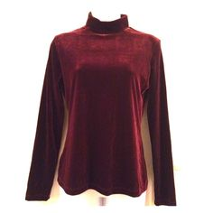 Burgundy Turtleneck/Top Love this beautiful top! The velvet material is so nice and this will definitely keep you nice and warm. The neck is similar to a turtleneck and it zips in the back! This is super cute with jeans! 90% Polyester 10% Spandex NWT! PRICE IS NOT FIRM OFFERS ACCEPTED UPON REQUEST... the top modeled is brown. Collection Fiftynine Tops Blouses