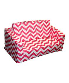 Amp up the energy in any child's room with this chic zigzag couch. The seat flips out for an easy-access relaxation or napping spot, and the removable slipcover makes cleaning a breeze.