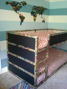 My Ikea Kura bed hack. Lots of Modge Podge, cheap old comics, time and patience. I used black chalkboard paint on the outside panels.