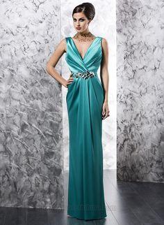 Ice aqua-marine silk-satin gown with deep v-neckline & bold crystal waistline accent by Valeria Luna