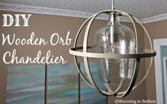 DIY Wooden Orb Chandelier. Make your own Rustic Wooden Orb Pendant light. Wooden embroidery hoops make it super easy and completely customizable.