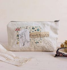 Zipper pouch great to use as a pencil case, cosmetics bag, hair accessories bag, jewelry case, sewing bag and so much more. A super pretty multipurpose pouch made with rare, stunning antique French floral fabrics and lace. This sweet little pouch has been made with antique hemp and