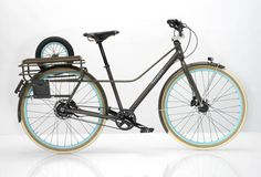 "The Fremont Bike by Ziba - I'm just charmed by its looks. The collapsible ""sidecar"" and canvas bag? Genius! It's fun just imagining what I might tote around in a bag like that."