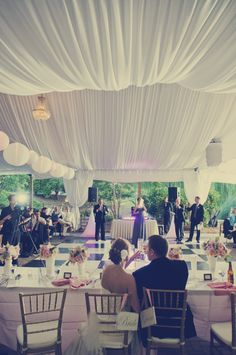 Toasts to the bride and groom! #gardentent #reception #parktavern