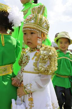 Little girl in national dress in the Yakut holiday Ysyakh