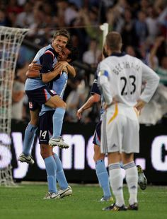 Classic Game: 27 Nov, 2007 - Sydney FC v Los Angeles Galaxy. Juninho celebrates with Brosque who scored twice in Sydney's win over Beckam's MLS side in front of a capacity crowd of in Sydney. Sydney Fc, David Beckham, Crowd, Champion, Game, Celebrities, Classic, La Galaxy, Gaming