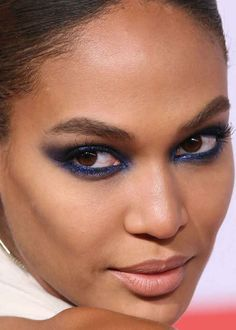 Close-up of Joan Smalls at the 2015 CFDA Fashion Awards.loving the blue smoky eye and the pink nude lip! For this smoky eye, I would recommend the new eyeshadow palette from the NEW Illamasqua To Be Alive Collection!