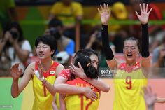 China's Yuan Xinyue (L) and China's Zhang Changning celebrate after winning…
