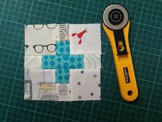 """Low volume fabrics, cut four 2 1/2"""" squares and four 1 1/2"""" squares. Plus fabric, cut two 1 1/2"""" squares and one 3 1/2"""" x 1 1/2"""" rectangle. Block is 5 1/2"""" unfinished. This size is perfect for making a pillow or pouch. Dimensions for a bigger block using charm squares in the corners are here.. www.flickr.com/photos/wooden_spoon/8584301543/"""