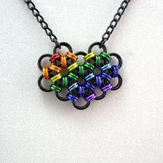 The True Colors Rainbow Pride Heart Pendant is hand woven in anodized aluminum giving it both vivid color and a very light weight. The pendant