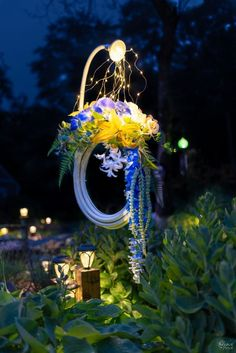 In this simple tutorial, we'll show you how to make a stunning lighted garden hose wreath. Day or night, on a door or in a garden - it looks fantastic! Wreaths For Front Door, Mesh Wreaths, Floral Wreaths, Burlap Wreaths, Front Porch, Garden Crafts, Garden Art, Garden Whimsy, Garden Design
