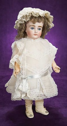 "18"" German bisque child with closed mouth by J.D. Kestner, circa 1885, marked 13. Beautiful early model wears antique costume."