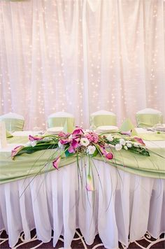 Green wedding decor with pink flowers