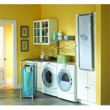 Hmmmm... Maybe the next house will have yellow walls in the laundry room (not quite this color) to compliment our blue washer & dryer. :)