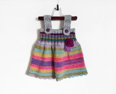 Knitted Girl Tunic Dress made from wool, mohair, acrylic yarn.  Crocheted edging and decorated with crochet flower and heart buttons.    Size: 9 - 12 months (74 - 80 cm)    Measurements:    Dress/Tunic:  Full length: 16.5 (42 cm)  Finished Chest: 17.3 - 18.9 (44 - 48 cm)    Care instructions:  Washing machine on gentle in cool water (recommended to put in wash bag).    Ready to ship.    Thank you for looking!    ☼ To see more Dresses made by me, please click here:  http://www.e...