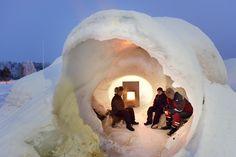 Tulikivi Harmaja fireplace in an ice igloo, next to the Sagrada Familia in Ice.  North Karelia, Finland.