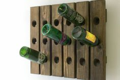 This wine rack is sure to add to any room with its beautiful symetry and natural wood finish. Holds up to 18 bottles, yet takes up very little space.