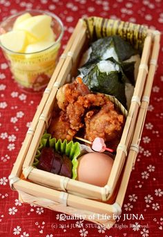 Japanese Bento Boxed Lunch with Fried Chicken and Rice Balls お弁当