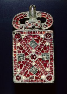 Visigothic Belt Buckle, c. 525-560 CE. Bronze with garnets, glass, mother of pearl, gold foil, traces of gilding; bronze and glass.