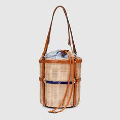 Shop the Wicker small bucket shoulder bag by Gucci. Imbued with a summer  feel that 4265b5130de2e