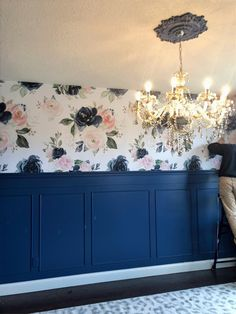 floral peel and stick wallpaper with diy wainscoting painted blue ceiling medallion and champagne crystal chandelier