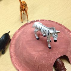 Homemade cave for zoo animal preposition activity.