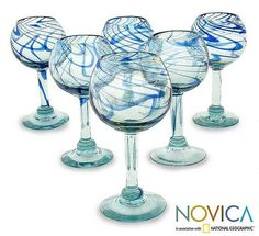 You will hear mariachi music accompanied by a rolling ocean when enjoying a beverage from these hand-blown wine glasses. Made from crystalline-blown glass with swirling blue ribbons, each glass will be slightly different in your six-pack.
