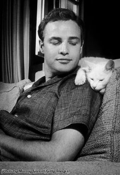 Marlon Brando with his cat, 1954.